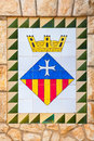 Calafell town coat of arms on the old stone wall catalonia tarragona region spain Stock Photos
