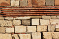 Calcareous stones and red bricks texture Royalty Free Stock Photo