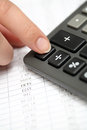 Calculating on a calculator financial statements close up Stock Photos