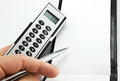 Calculation making a with calculator Royalty Free Stock Image