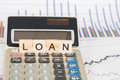 Calculator and business data with the word loan Royalty Free Stock Photo