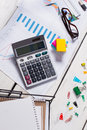 Calculator with charts and office stationery. Royalty Free Stock Photo