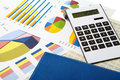 Calculator and diagrams on a business background pen finance accounting Royalty Free Stock Image