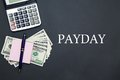 Calculator and Dollars with message PAYDAY Royalty Free Stock Photo