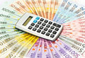 Calculator on euro banknotes Royalty Free Stock Image