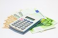 Calculator on Euro notes Royalty Free Stock Photo