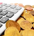 The calculator and gold coins. Royalty Free Stock Photo