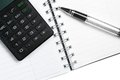 Calculator notebook and business pen top of view of on white table Royalty Free Stock Photography