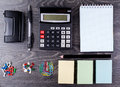 The calculator, notebook, leaflets for record and stationery Royalty Free Stock Photo