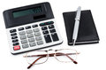 Calculator, notepad, pen and glasses isolated on white Royalty Free Stock Photo