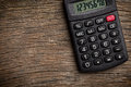 Calculator on old wooden table Royalty Free Stock Photography