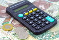Calculator over money background polish zloty Royalty Free Stock Image