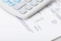 Calculator over utility bill studio shot Stock Photos