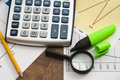 Calculator on paper table with diagram Royalty Free Stock Photo