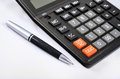 Calculator and pen Royalty Free Stock Images