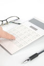 Calculator and pen with glasses Royalty Free Stock Photo