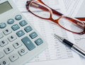 Calculator,pen,glasses and financial documents. Royalty Free Stock Photo