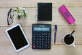 Calculator with pen and office equipment on desktop Royalty Free Stock Photo