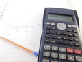 Calculator, pen and sheets.