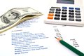 Calculator and pencil and dollars Royalty Free Stock Photos