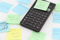 Calculator with postit about stress a a series of on white background Royalty Free Stock Images