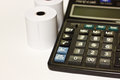 Calculator roll on white paper Royalty Free Stock Images