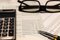 Calculator on saving account with pen and glasses Royalty Free Stock Photography