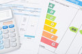 Calculator with utility bill and energy rating chart Royalty Free Stock Photo