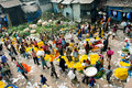Calcutta india view of mullik ghat flower market with people scurrying around the is more than years old more than sellers work in Stock Photography