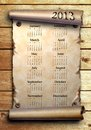 Calendar 2013 Scroll of old paper on wooden boards Royalty Free Stock Photos