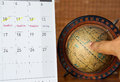 Calendar with antique globe vacation remark and vintage global map finger point to the map Stock Photography