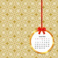 Calendar 2017 in golden circle frame with red bow on vintage decor seamless pattern Royalty Free Stock Photo