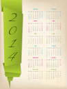 Calendar with green origami arrow paper on light background Royalty Free Stock Photo