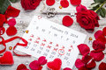 Calendar page with the red hearts and petals Royalty Free Stock Images