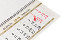 Calendar page with red thumbtack on february closeup Stock Photo