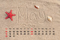 Calendar with starfish and seashells on sand beach. May 2016 Royalty Free Stock Photo