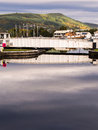 Calendonian canal scotland bridge over caledonian with a cloudy autumn sky reflected in the still waters inverness Stock Images