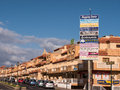 Caleta de fuste holiday resort fuerteventura a street with apartments and shopping centre catering mainly for english tourists in Stock Images