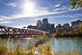 Calgary pedestrian bridge a across bow river in with skyscrapers in the background Royalty Free Stock Photos