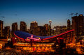 Calgary s skyline at night dusk with the scotiabank saddledome in the foreground the saddledome with its unique saddle shape is Royalty Free Stock Photography