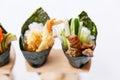 California Hand Roll Sushi Set : Shrimp Tempura and Crispy Tuna Skin with Sliced Cucumber. Royalty Free Stock Photo