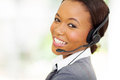 Call center employee headshot of beautiful female african Royalty Free Stock Images