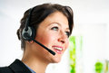 Call center employee smiling Royalty Free Stock Images