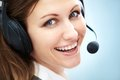 Call center operator portrait of smiling support phone in headset over blue background Royalty Free Stock Photo