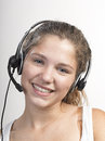 Call center woman with headset on grey Royalty Free Stock Photo