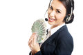 Call center woman holding a clip of polish money Royalty Free Stock Photo