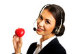 Call center woman holding heart model Royalty Free Stock Photo