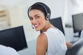 Call centre agent looking over shoulder with her headset Royalty Free Stock Photos