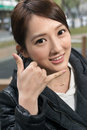 Call me gesture asian young woman give you a of closeup portrait Royalty Free Stock Photos