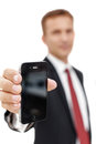 Call us if you have a problem businessman holding cell phone isolated on the white background Royalty Free Stock Photos